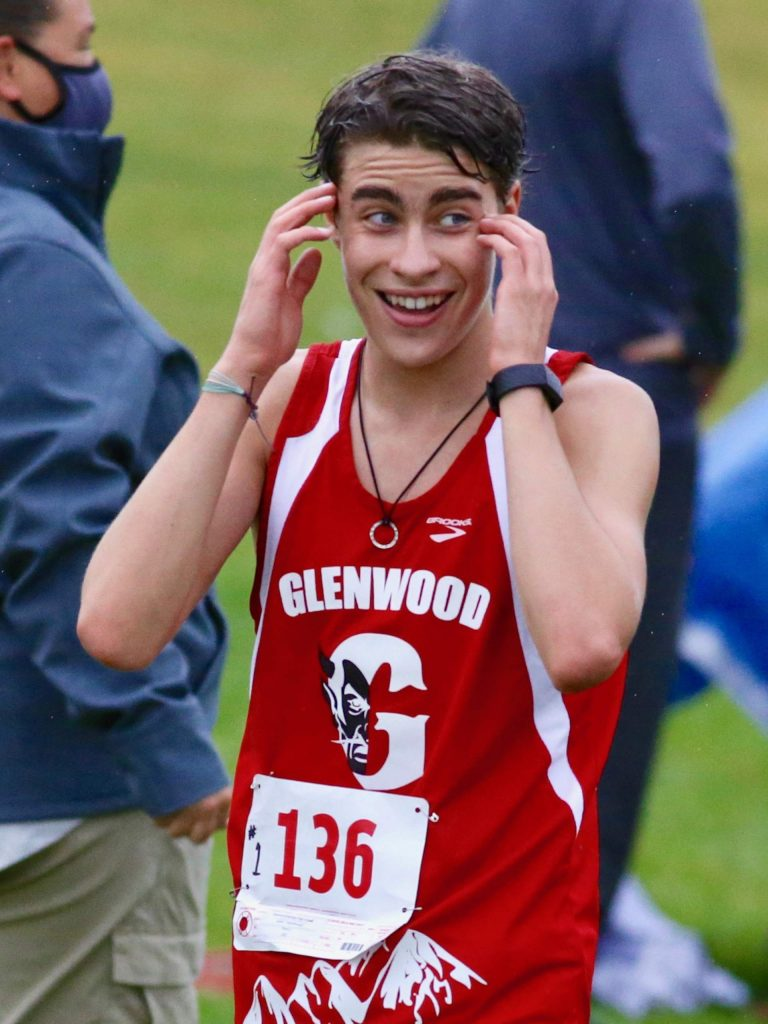 Glenwood's Quinn MacPherson reacts after finishing fifth in the Longhorn Invitational cross country meet on Saturday, Aug. 29, 2020, at Crown Mountain Park in El Jebel. (Photo by Austin Colbert/The Aspen Times)