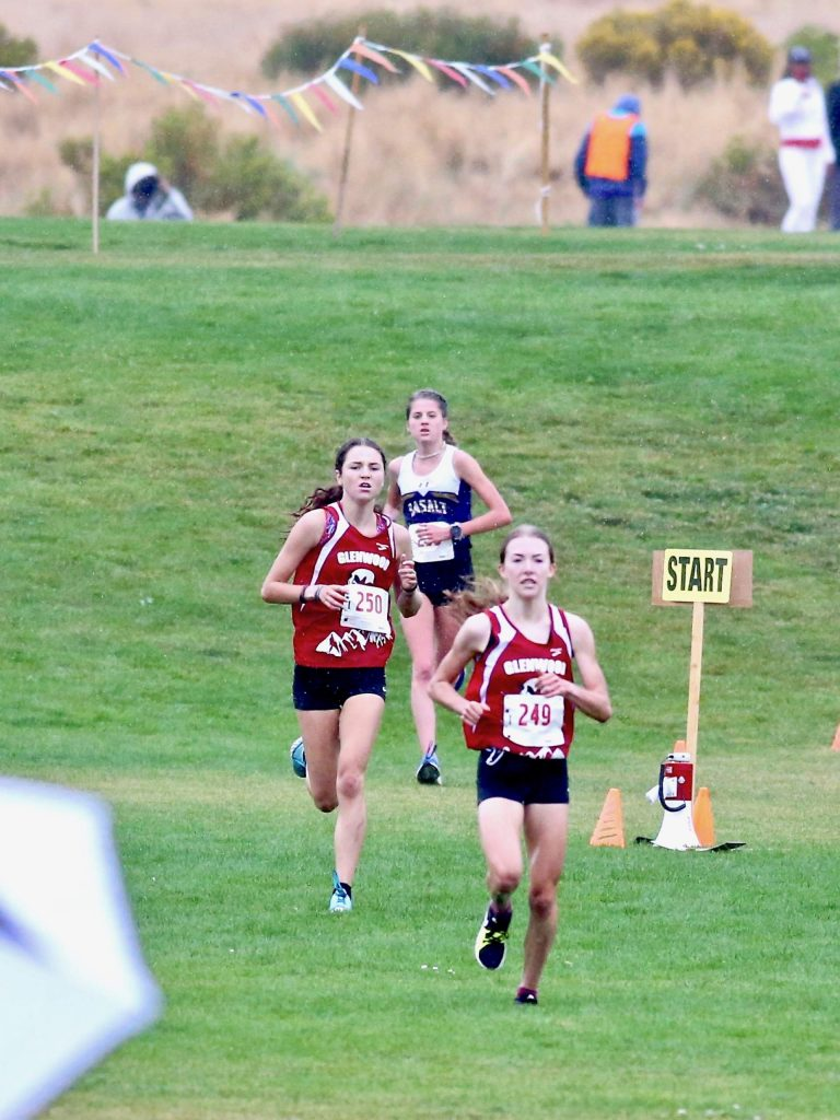Glenwood's Ella Johnson leads teammate Sophia Connerton-Nevin and Basalt's Sierra Bower down the final stretch of the Longhorn Invitational cross country meet on Saturday, Aug. 29, 2020, at Crown Mountain Park in El Jebel. (Photo by Austin Colbert/The Aspen Times)