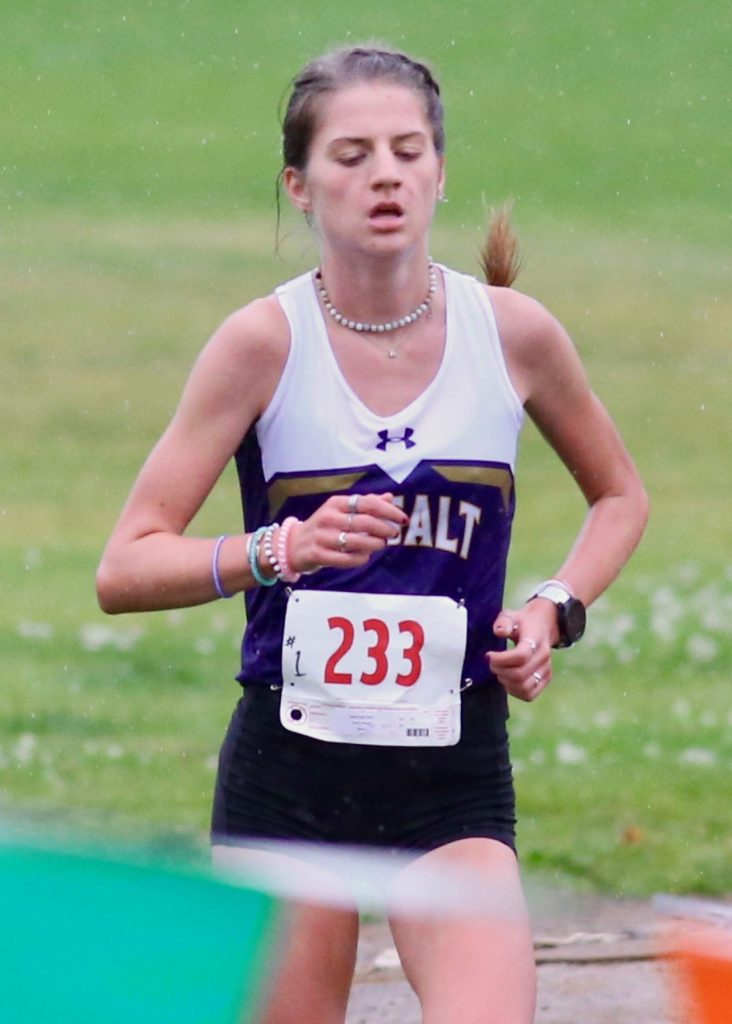 Basalt senior Sierra Bower reaches the finish line of the Longhorn Invitational cross country meet on Saturday, Aug. 29, 2020, at Crown Mountain Park in El Jebel. (Photo by Austin Colbert/The Aspen Times)