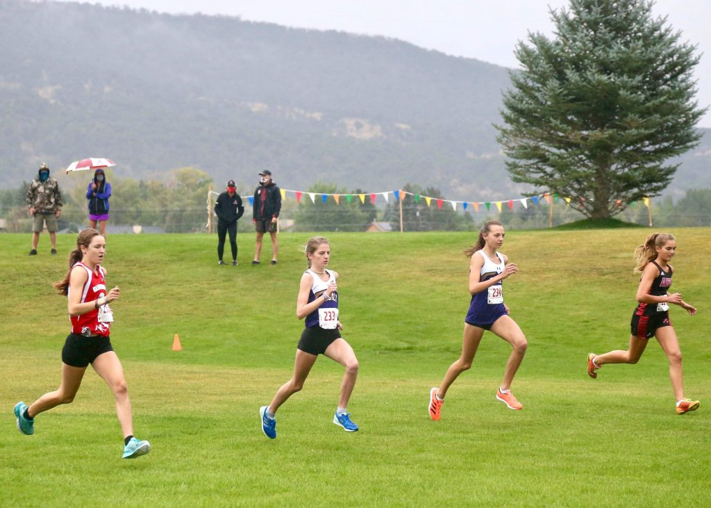 From left, Glenwood's Sophia Connerton-Nevin, Basalt's Sierra Bower, Basalt's Katelyn Maley and Aspen's Kylie Kenny compete in the Longhorn Invitational cross country meet on Saturday, Aug. 29, 2020, at Crown Mountain Park in El Jebel. (Photo by Austin Colbert/The Aspen Times)