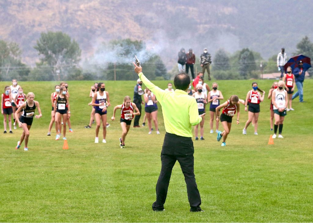 Smoke from the starting pistol drifts through the air as the first wave of runners take to the course at the Longhorn Invitational cross country meet on Saturday, Aug. 29, 2020, hosted by Basalt High School at Crown Mountain Park in El Jebel. (Photo by Austin Colbert/The Aspen Times)