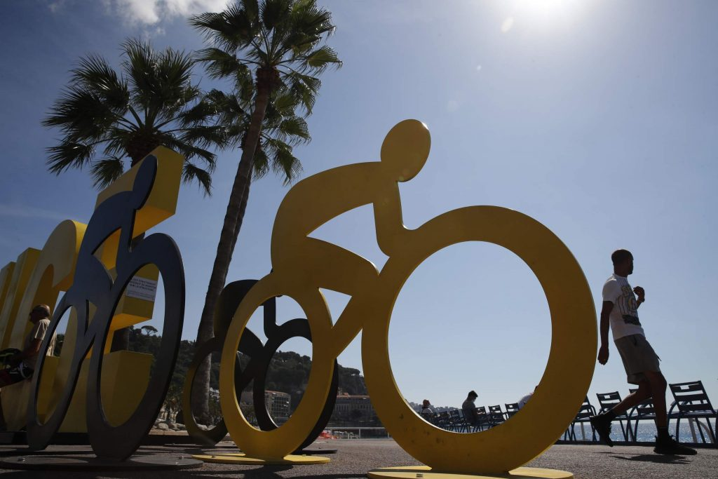 A man walks past an installation set up for the start of the 107th Tour de France cycling race, in Nice, southern France, Thursday, Aug. 27, 2020. The Tour de France sets off shrouded in uncertainty and riding in the face of the coronavirus pandemic and mounting infections in France.