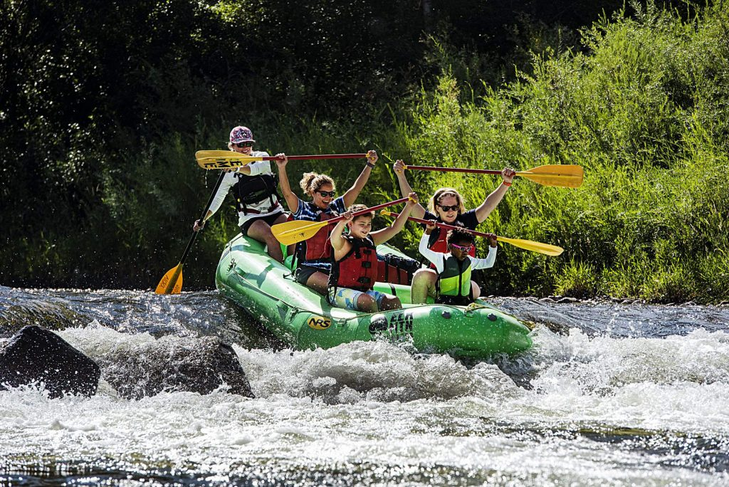 Elk Mountain Expeditions clients float down the Roaring Fork River in Basalt on Thursday, August 6, 2020. This stretch of river is what the Elk Mountain Expeditions guides consider their class 2 family float and they guide it twice a day. This summer is the ninth season for the company. (Kelsey Brunner/The Aspen Times)