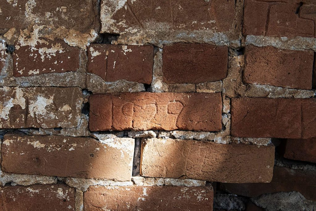 "A carving with ""1929"" is etched into a brick on the chicken coop at Glassier Open Space in Basalt on Thursday, August 6, 2020. (Kelsey Brunner/The Aspen Times)"