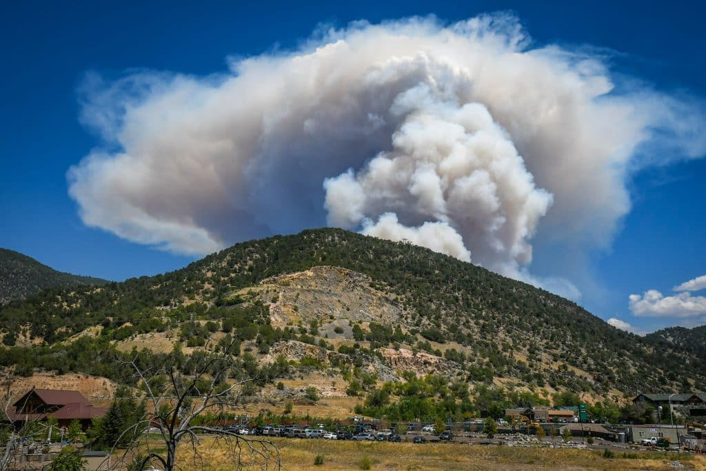 Smoke from the Grizzly Creek Fire in Glenwood Canyon billows over the Glenwood Springs Adventure Park on Monday afternoon.