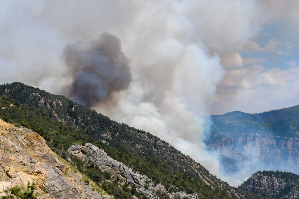 Smoke billows from the canyon walls as the Grizzly Creek Fire exploads in Glenwood Canyon on Monday afternoon.
