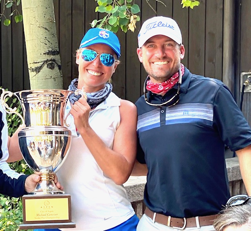 Lori Lintjer, left, stands with Andrew Firman, first assistant golf professional, after winning the ladies flight of the 2020 Conviser Cup at Aspen Golf Club.