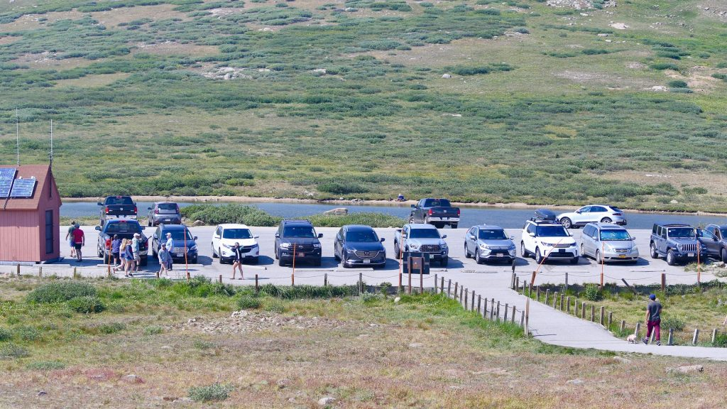 Vehicles park at the top of Independence Pass on Saturday, Aug. 15, 2020. After a brief closure because of extra traffic related to the Grizzly Creek Fire, which closed I-70, things were seemingly back to normal in regard to getting over the pass on Saturday. (Photo by Austin Colbert/The Aspen Times)