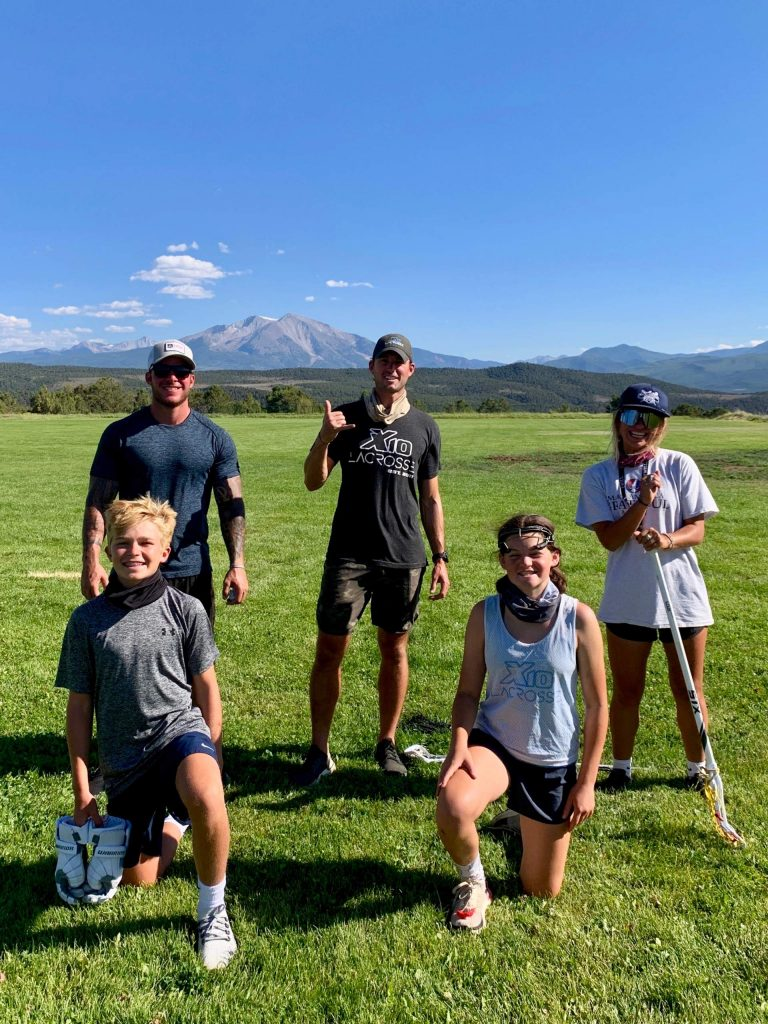 Michael Goerne Award winners Evan Calkins, front left, and Charlotte Rooney, front right, pose with coaches Tommy Cox, back left, Chris Bocklet, back middle, and Amanda Trendell at the conclusion of the X10 Lacrosse camp late last month in Glenwood Springs.