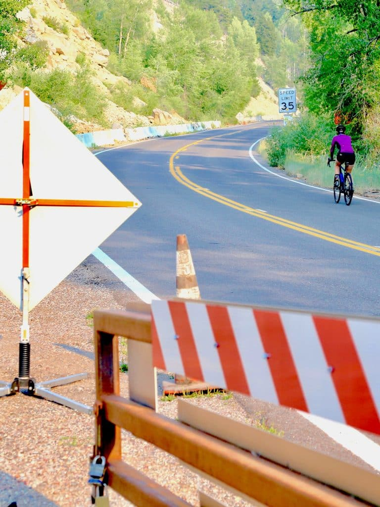 A cyclist heads up Independence Pass from Aspen on Friday, Aug. 14, 2020. (Photo by Austin Colbert/The Aspen Times)