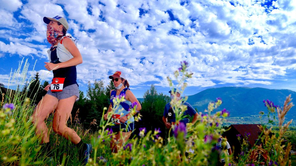 Sara Martin, left, of Colorado Springs, leads a group of runners as they take off from the start of the Audi Power of Two trail run on Sunday, Aug. 2, 2020, at the base of Tiehack. (Photo by Austin Colbert/The Aspen Times)