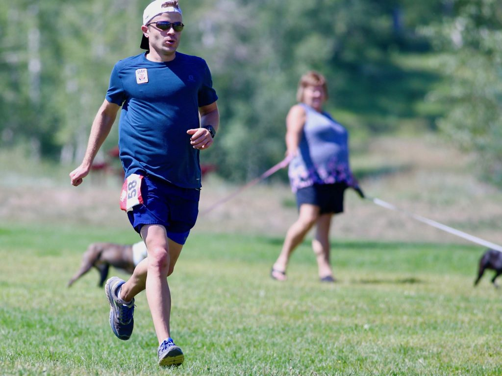 Basalt's Andrew Amato approaches the finish line of the Audi Power of Two trail run on Sunday, Aug. 2, 2020, in Snowmass Village. Amato finished third among men. (Photo by Austin Colbert/The Aspen Times)