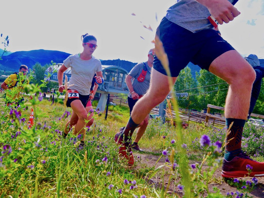 Eventual women's race winner Jessie Young, wearing No. 73, is part of a group of runners as they take off from the start of the Audi Power of Two trail run on Sunday, Aug. 2, 2020, at the base of Tiehack. (Photo by Austin Colbert/The Aspen Times)