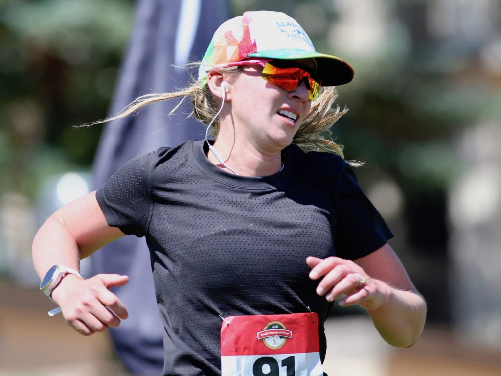 Edwards' Lauren Warkentin approaches the finish line of the Audi Power of Two trail run on Sunday, Aug. 2, 2020, in Snowmass Village. She finished third among women. (Photo by Austin Colbert/The Aspen Times)