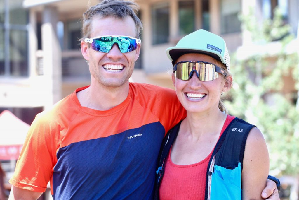 Aspen Olympian Simi Hamilton, left, and wife Sophie Caldwell, also a member of the U.S. cross-country ski team, pose for a photo following the Audi Power of Two trail run on Sunday, Aug. 2, 2020, in Snowmass Village. Caldwell was second among women on Sunday, while Hamilton won the Power of Four trail run on Saturday. (Photo by Austin Colbert/The Aspen Times)