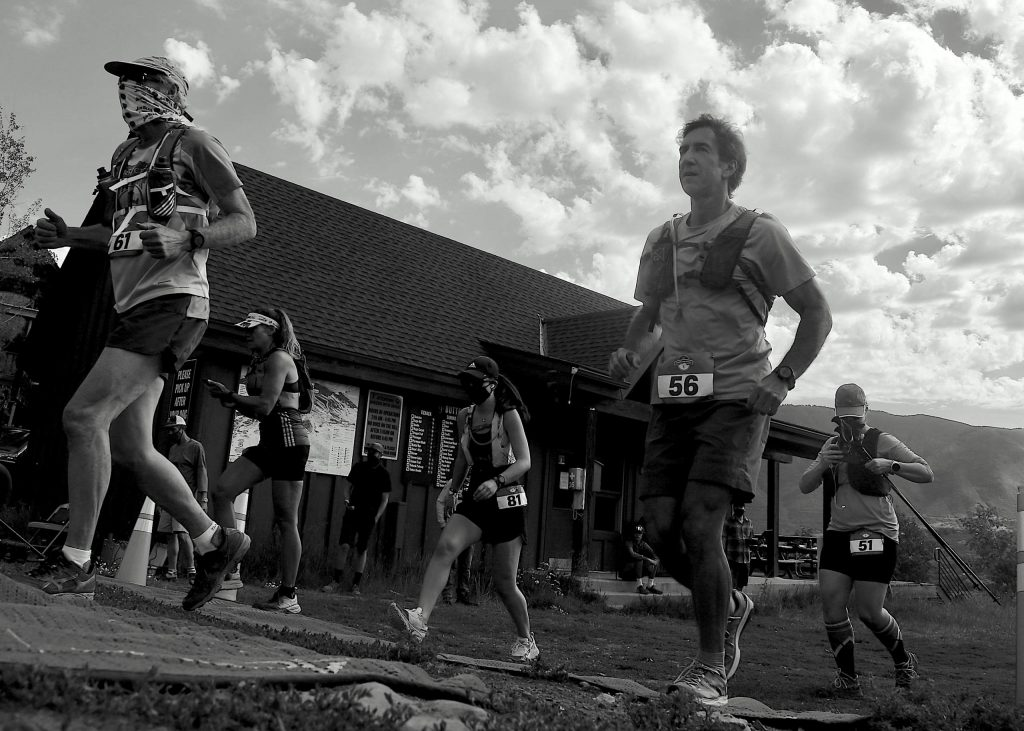 Runners take off from the start of the Audi Power of Two trail run on Sunday, Aug. 2, 2020, at the base of Tiehack. (Photo by Austin Colbert/The Aspen Times)