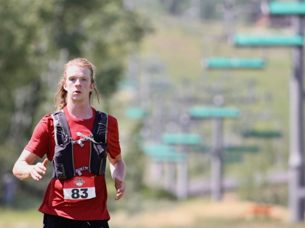 Carbondale's Bryn Peterson approaches the finish line of the Audi Power of Two trail run on Sunday, Aug. 2, 2020, in Snowmass Village. Peterson finished fourth among men. (Photo by Austin Colbert/The Aspen Times)