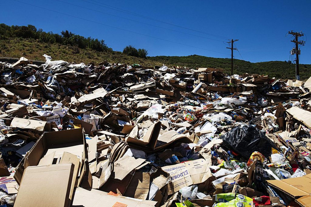 Cardboard is piled up in the recycling area at the Pitkin County Solid Waste Center in Aspen on Friday, August 7, 2020. (Kelsey Brunner/The Aspen Times)