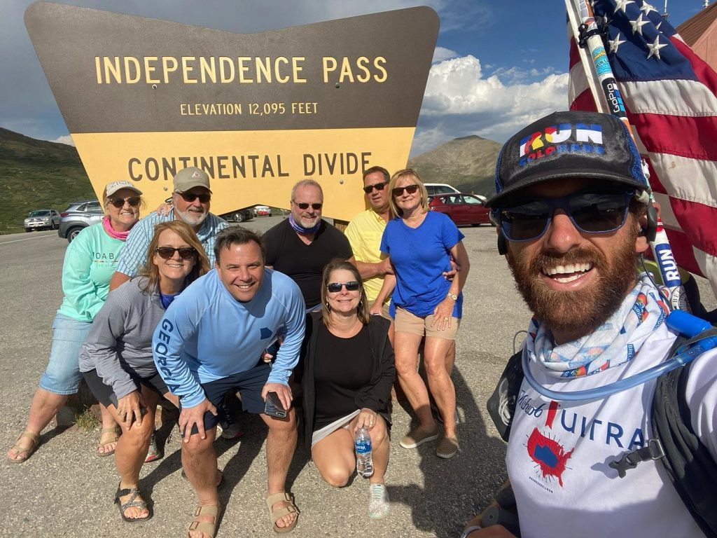 Russell Larkins poses with random supporters atop Independence Pass earlier this week as part of his cross-country run to raise money and awareness for veterans struggling with PTSD and other mental ailments.
