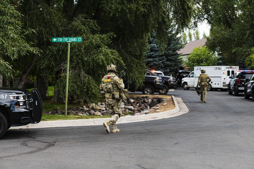 Officers of Eagle County's Special Operations Unit approach the scene on Evans Court in Basalt on Thursday, August 27, 2020.