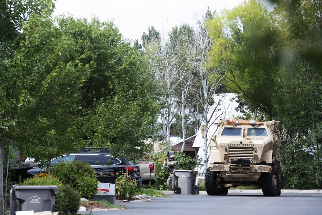 An officer from Eagle County Special Operations Unit approaches the unit to finish sweeping the area after a disturbance on Evans Court in Basalt on Thursday, August 27, 2020.
