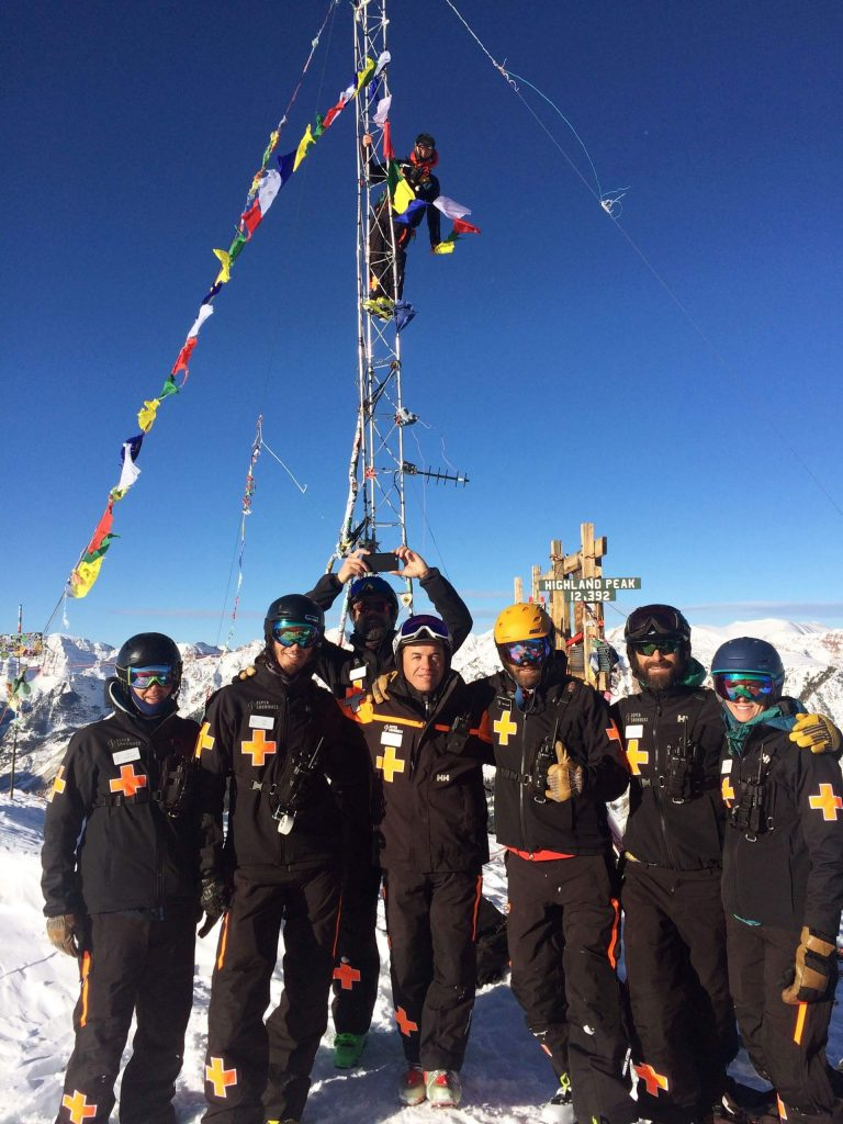 Mario Ruiz, center, with no goggles, stands with his new mates from the Aspen Highlands Ski Patrol last winter. Ruiz participated in the ski patrol exchange.