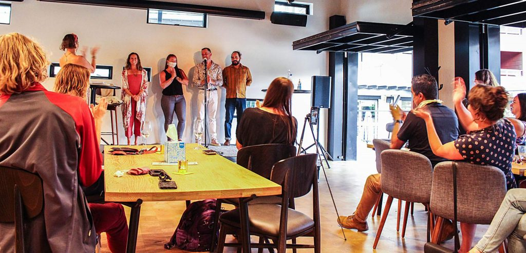 From left, Alya Howe claps for Oriana Moebius, Sarah Sanders, Jarrad Lee and AJ Finney at the end of the live story slam event at The Collective Aug. 9, 2020. (Maddie Vincent/Snowmass Sun)