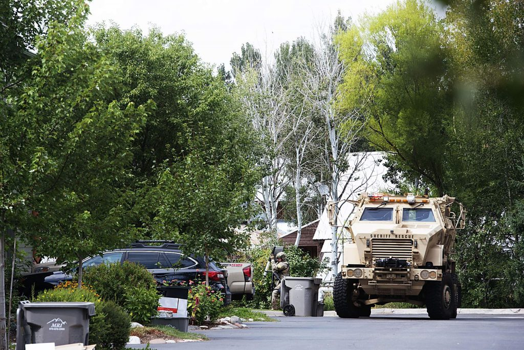 An officer from Eagle County Special Operations Unit approaches the unit to finish sweeping the area after a disturbance on Evans Court in Basalt on Thursday, August 27, 2020. (Kelsey Brunner/The Aspen Times)