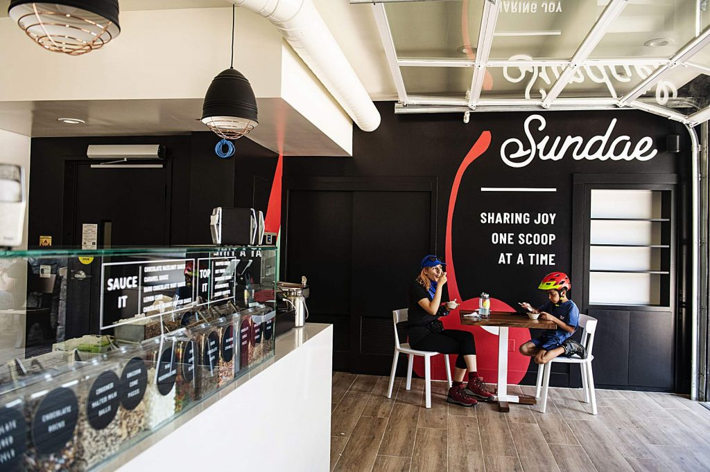Aurora Chavez, left, and Tiago Canales, 9, enjoy a scoop from Sundae in Snowmass Base Village on Thursday, July 30, 2020.