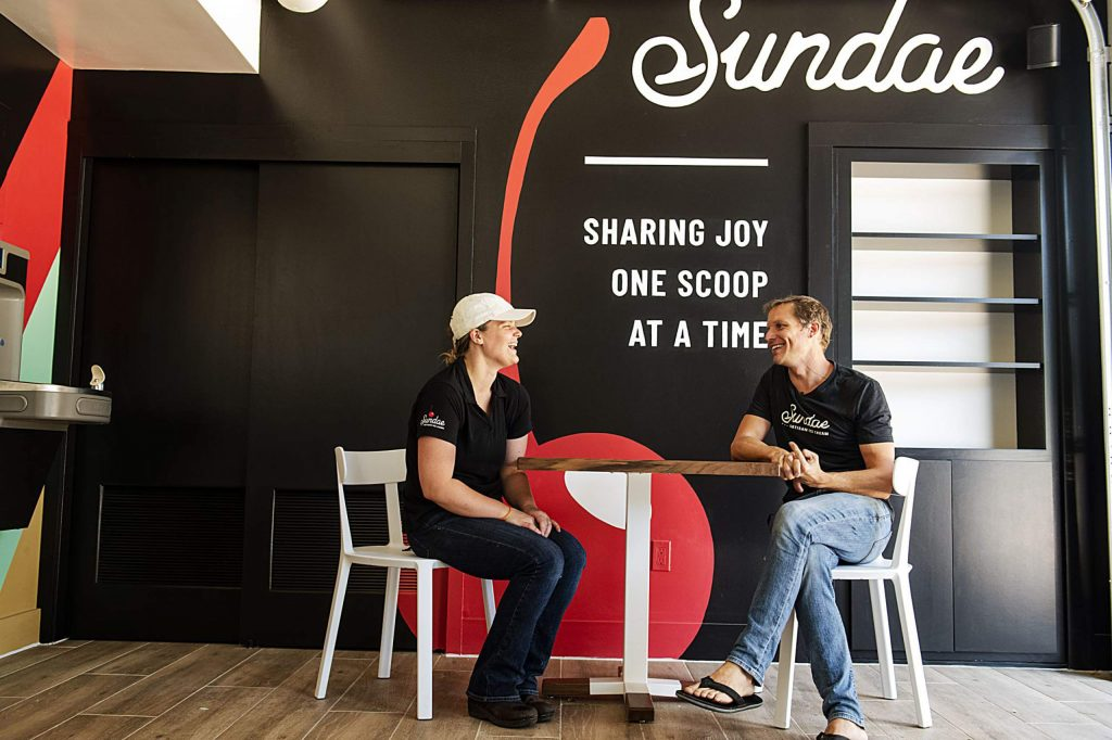 Sundae general manager Ashlyn Streetz, left, and owner Kent Beidel share a conversation in the artisan ice cream shop in Snowmass Base Village on Thursday, July 30, 2020.