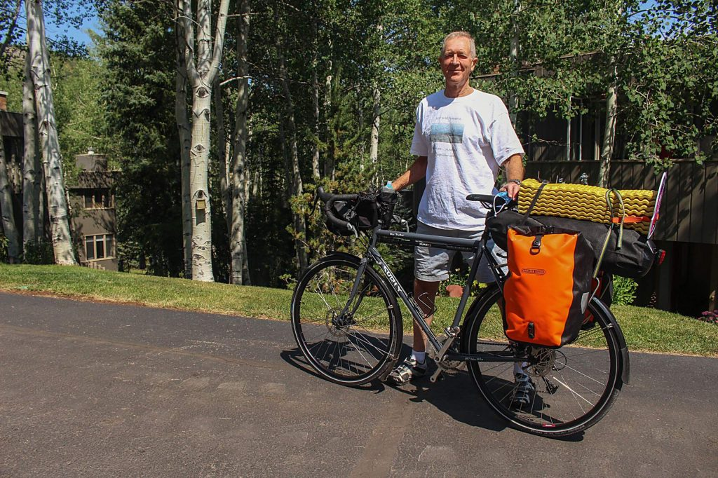 George Russell, 73, stands outside of his Snowmass Village home with the bike he plans to ride from California to Florida. Russell, a Scotland native, is making the cross-country cycling trek to raise money for the National Trust for Scotland.
