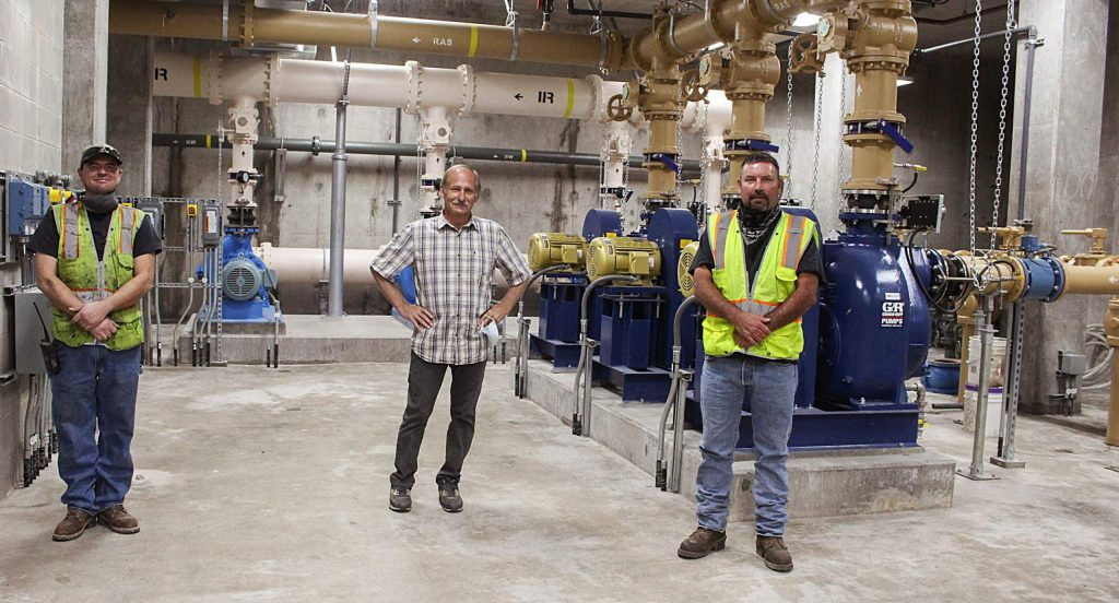 From left, Jason Fineran, Kit Hamby and John Bell stand inside of the Snowmass Water and Sanitation District's new wastewater treatment facility on Aug. 3, 2020. (Maddie Vincent/Snowmass Sun)
