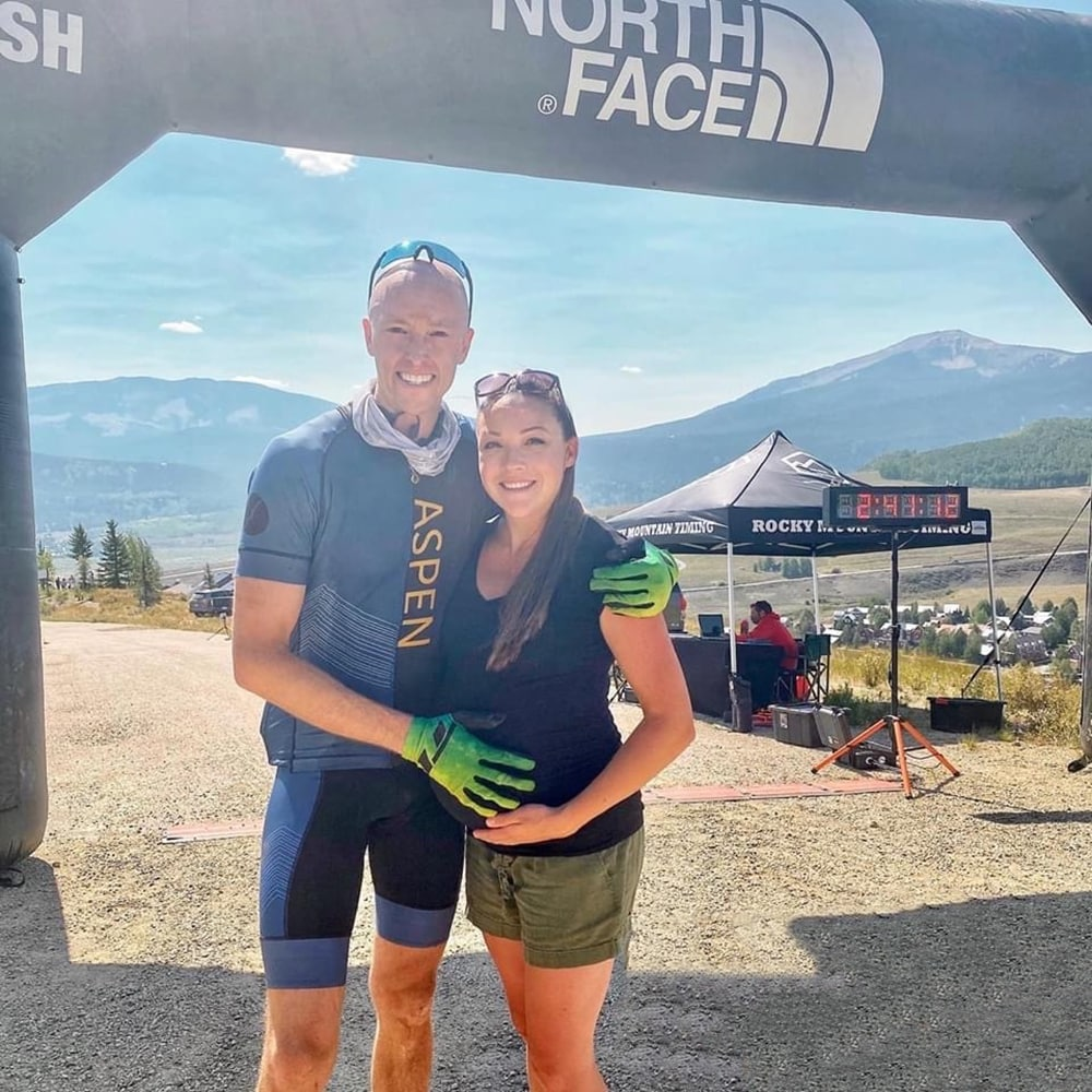 Mountain biker Jonathan Fillman at the finishline with his wife, Stephanie, after a grueling 40+ miles of riding the Crested Butte Mountain Bike.