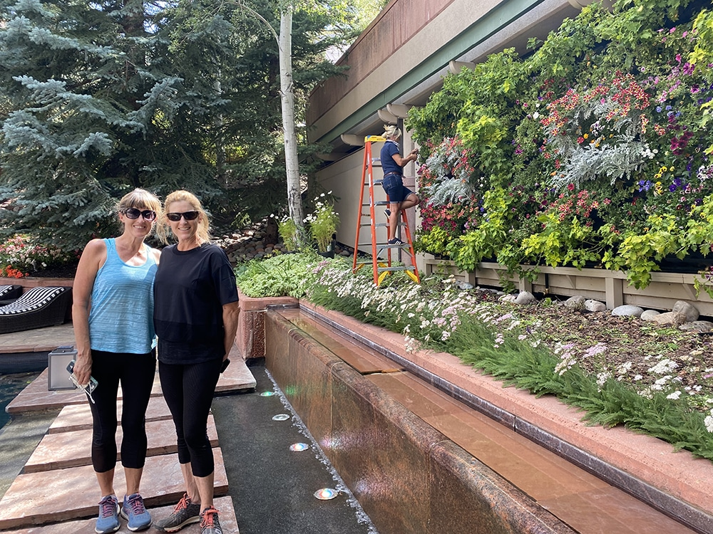 Sisters Evie and Colleen Clare visit the living wall at The Nell, designed by Arabella Beavers in the background.
