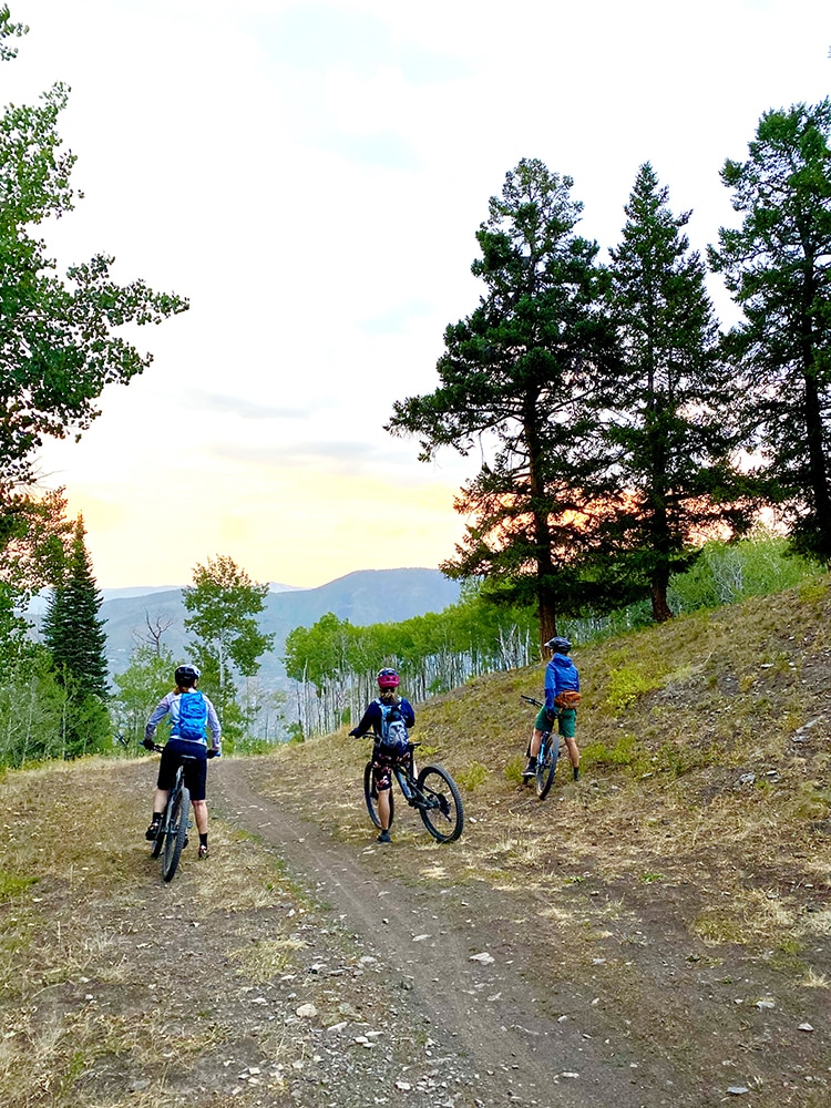 Friends Diana Ettlinger, MarySue Bonetti and Christy Mahon take in the views during a Buttermilk mountain bike ride.