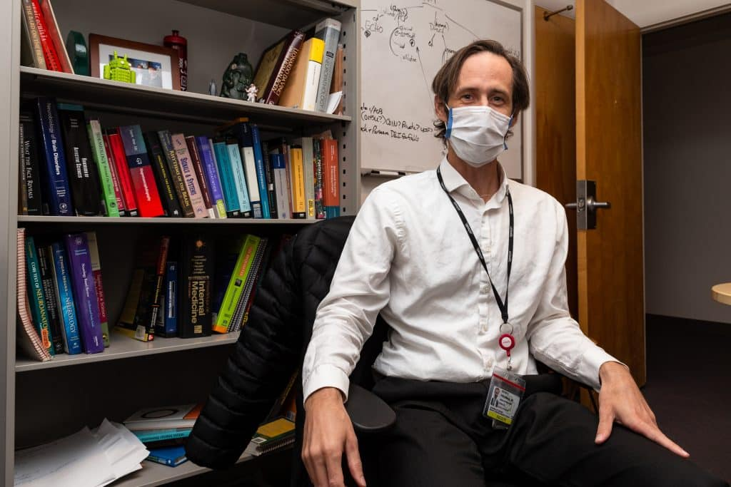 Assistant Professor for the Department of Neurology, Dr. Peter S. Pressman works in his office at the University of Colorado's Anschutz Medical Campus in Aurora, Colo. on Thursday, Sept. 10, 2020. (Photo by Liz Copan / Studio Copan)