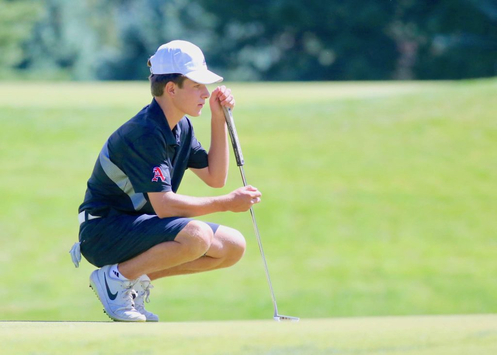 Aspen High School's Nic Pevny lines up a putt during the team's golf tournament on Monday, Sept. 14, 2020, at Aspen Golf Club. (Photo by Austin Colbert/The Aspen Times)