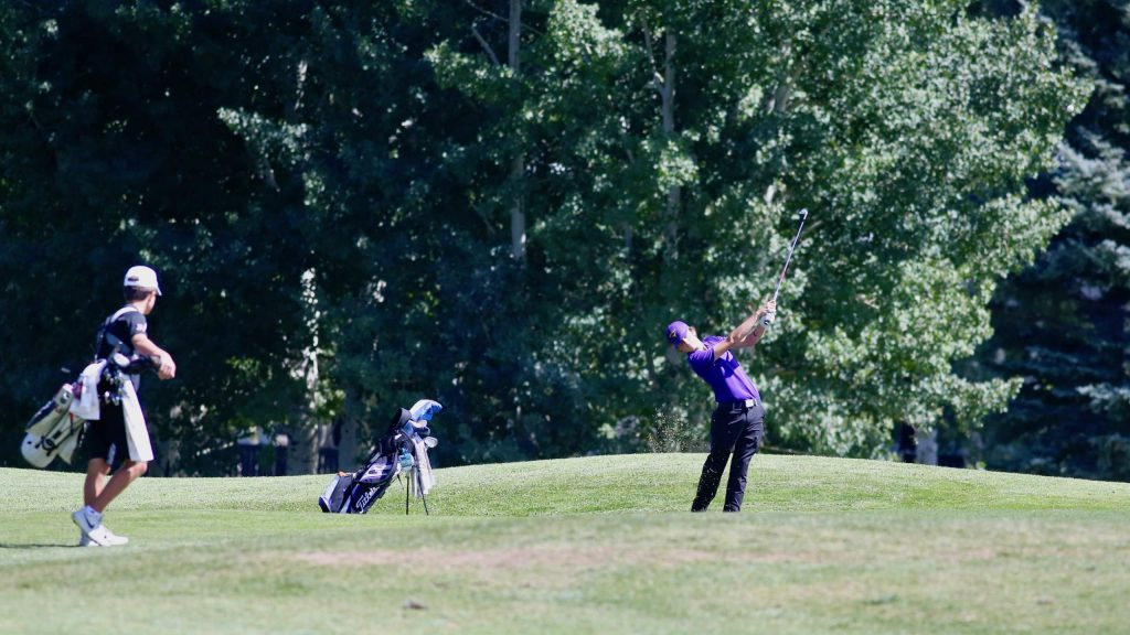 Basalt's Tyler Sims, right, hits his approach shot on hole No. 18 during the Aspen High School golf tournament on Monday, Sept. 14, 2020, at Aspen Golf Club. (Photo by Austin Colbert/The Aspen Times)