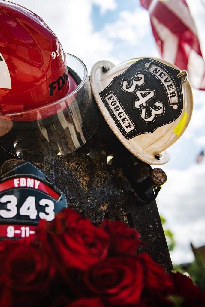 An American flag waves Friday behind the 911 memorial at the Aspen Fire Department. The annual public event at the downtown station was canceled because of conoravirus concerns. (Kelsey Brunner/The Aspen Times)