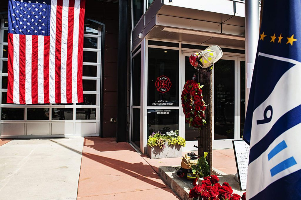 Flowers were placed Friday at the memorial to those lost on Sept. 11, 2001, outside of Aspen Fire Department. The annual public event at the downtown station, which has a piece of the Twin Towers as a memorial, was canceled because of conoravirus concerns. (Kelsey Brunner/The Aspen Times)
