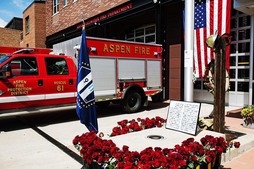 Flowers were placed Friday at the memorial to those lost on Sept. 11, 2001, outside of Aspen Fire Department. The annual public event at the downtown station was canceled because of conoravirus concerns. (Kelsey Brunner/The Aspen Times)