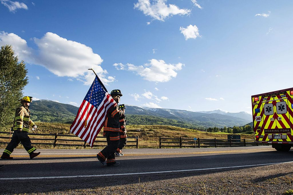 Local firefighters walk to the top of Snowmass Village to honor those fallen on 9/11 during the fifth annual Axes and Arms climb on Friday, Sept. 11, 2020. The firefighters gain 956 feet in elevation during the march wearing their full gear. (Kelsey Brunner/The Aspen Times)