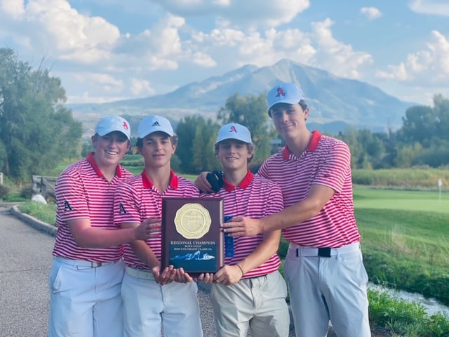 The Aspen High School boys golf team poses with the regional championship trophy.