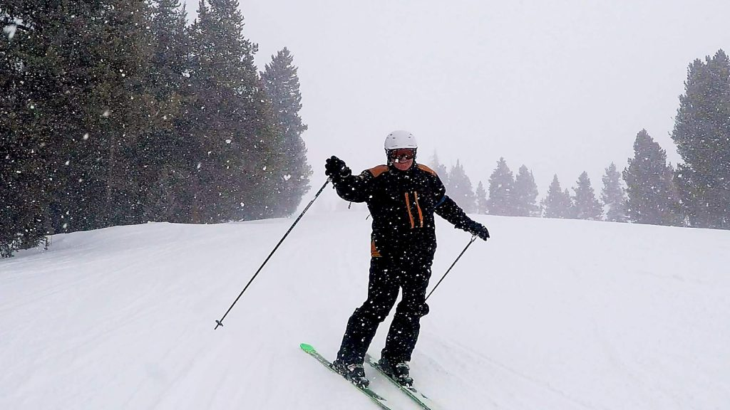 A patient with The Steadman Clinic enjoys some powdery turns on Vail Mountain during the clinic's ski day for patients in January of 2020.