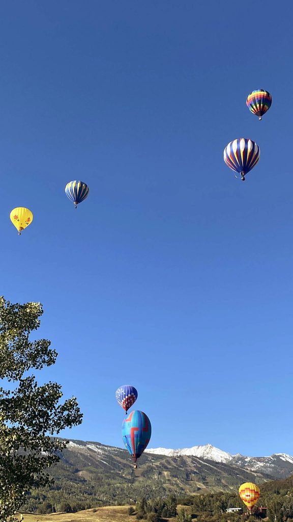 Hot air balloons fill the sky Saturday morning above Snowmass Village for the 45th annual Snowmass Balloon Festival.