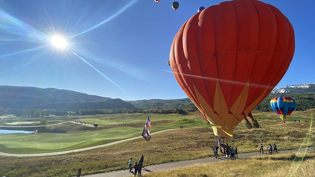 A hot air balloon gets walked back Saturday morning along the trail in Snowmass Village during the 45th annual Snowmass Balloon Festival. Hundreds of people watched from around Town Park and Brush Creek Road as the field was closed this year because of coronavirus concerns.