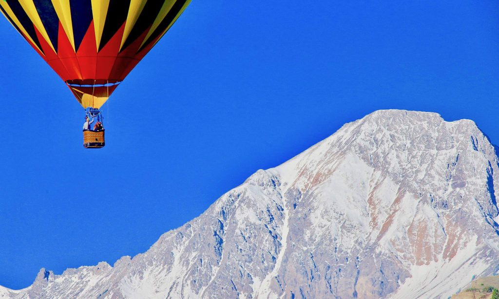 A balloon hovers in front of Mt. Daly during the Snowmass Balloon Festival on Saturday, Sept. 12, 2020, in Snowmass Village. (Photo by Austin Colbert/The Aspen Times)
