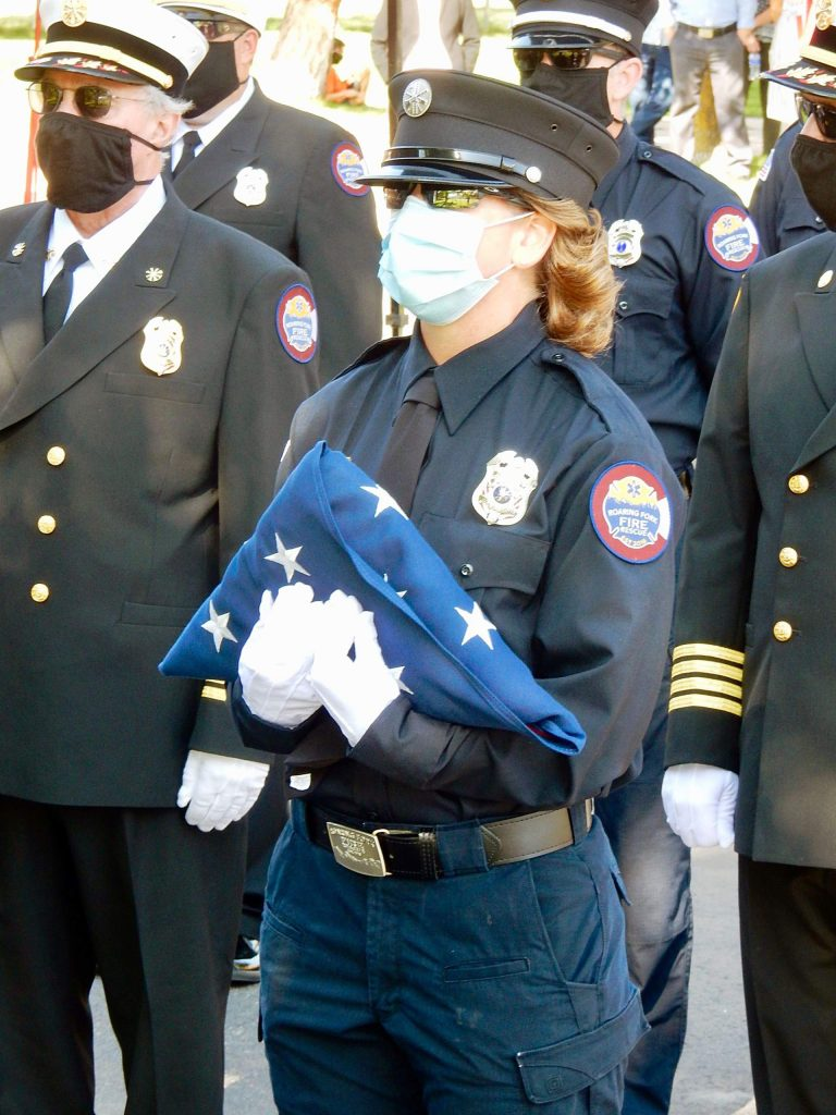 Christine Benton holds an American flag that was presented to her Friday, Sept. 25 at her retirement ceremony at Roaring Fork Fire Rescue.