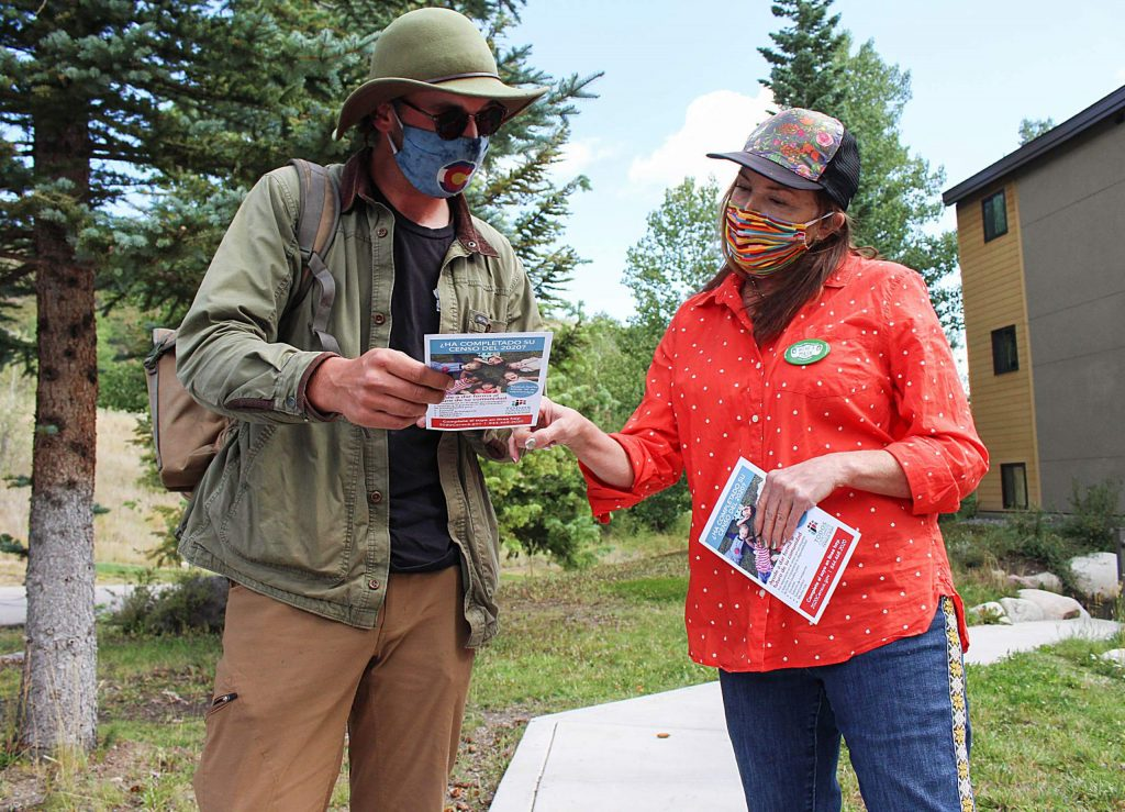 Mendy McConnell, right, with the Aspen to Parachute Complete Count Committee explains how Tucker Hawkins can complete his 2020 U.S. Census survey, Sept. 1, 2020. (Maddie Vincent/Snowmass Sun)