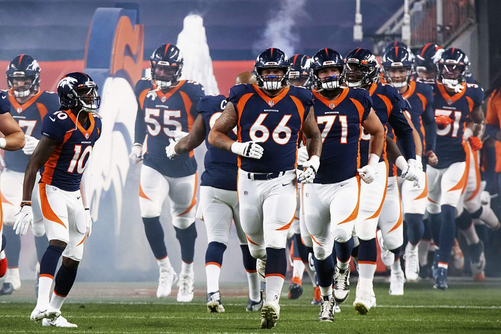 Denver Broncos wide receiver Jerry Jeudy (10) and Denver Broncos guard Dalton Risner (66) lead their team onto the field during introductions before of an NFL football game against the Tennessee Titans, Monday, Sept. 14, 2020, in Denver. (AP Photo/Justin Edmonds)
